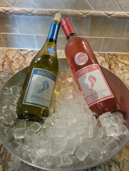 Gender Reveal party ideas:  white wine with tiny baby feet on pink & blue labels