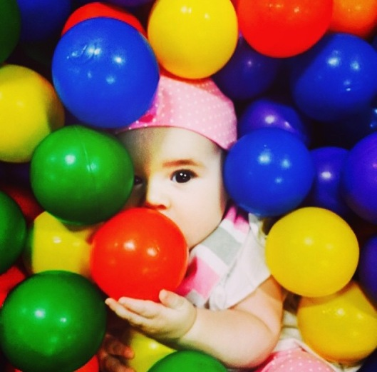 Baby in the ball pit! We love to play at Little Land Pay Gym -- all of their equipment is strong enough to hold babies and mamas (so I can swing too!)